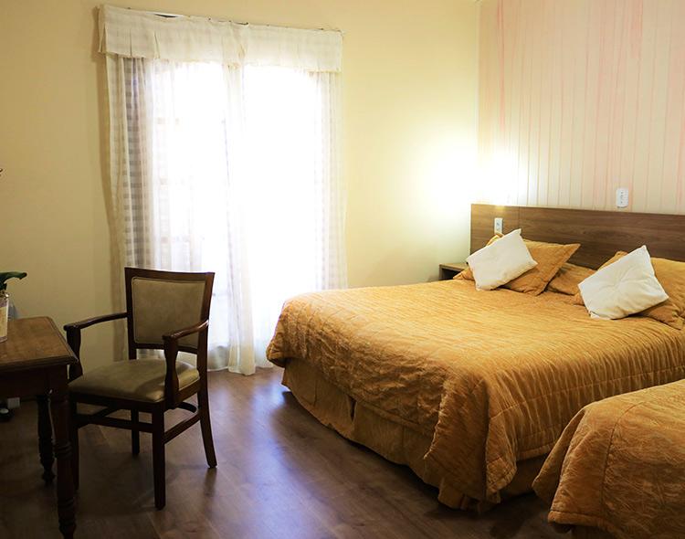 Quarto Hotel Bologna em Campos do Jordão Capivari